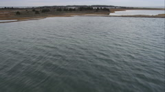Over Cape Poge Bay, approaching Shear Pen Pond, Massachusetts. Shot in November Stock Footage
