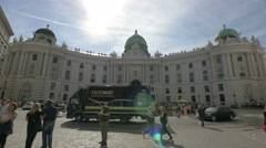 Stock Video Footage of Many people gathered in front of Hofburg Palace in Vienna