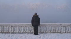 Man standing on the misty river bank Stock Footage