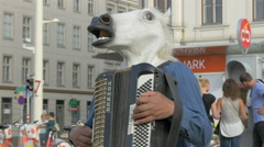 Stock Video Footage of Man wearing a horse head mask playing accordion in Vienna