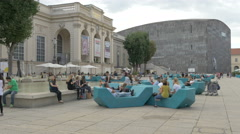 Adults and children relaxing in Museumplatz, Vienna Stock Footage