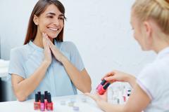 Manicure consultation Stock Photos
