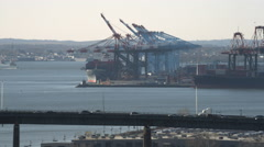 Aerial view of the Jersey Turnpike with Port Newark in the background. Shot in Stock Footage