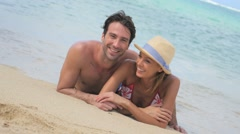 Couple relaxing on the beach in Caribbean island Stock Footage
