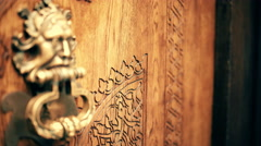 Focus pull over ancient wooden door on hand knocker. Stock Footage