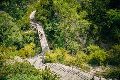 Tourists descend the steps to the mountain river Le Verdon in th - stock photo