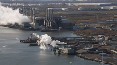 Aerial shot of industrial factories along the river. Shot in 2011. Stock Footage