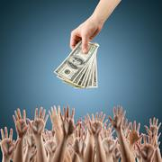 Hand with money on a blue background Money background - American dollars - stock photo