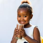 Cute african girl with milk chocolate drink. - stock photo