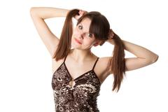 Young woman with two hair tails - stock photo