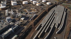 Aerial view of rail yard and industry; historic cemetery in background, New Stock Footage