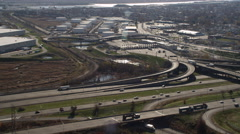 Aerial of traffic and toll booth in industrial section of New Jersey. Shot in Stock Footage