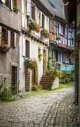 Alleyway with colourful half timbered houses Eguisheim Departement Haut Rhin Stock Photos