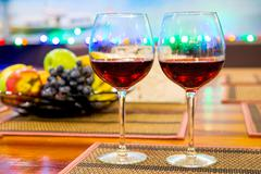Still Life stemware of wine and fresh fruit on the table Stock Photos