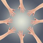 Group of eight hands at the circle together teamwork showing you Stock Photos