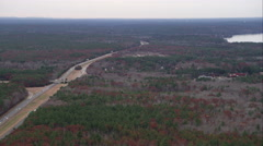 Over forest and highway south of Norwood, Massachusetts. Shot in November 2011. Stock Footage