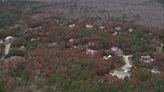 Over rural residential area among forest south of Norwood, Massachusetts. Shot Stock Footage