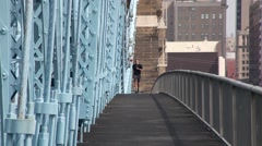 CINCINNATI_JOGGER ON ROEBLING BRIDGE_1 Stock Footage