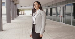 Business woman adjusting her hair outdoors Stock Footage