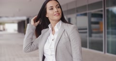 Business woman adjusting her hair outdoors - stock footage