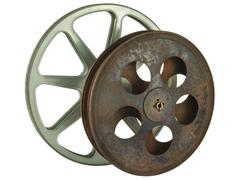Two vintage film reels isolated on white Stock Photos