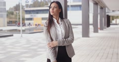 Grinning optimistic business woman - stock footage