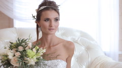 beautiful model (bride) at a photo shoot - stock footage