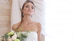 Stock Video Footage of beautiful model (bride) at a photo shoot