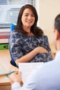 Pregnant Woman Having Appointment With Doctor In Surgery - stock photo