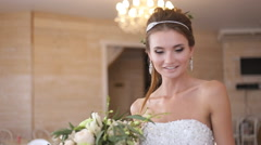 Beautiful model (bride) at a photo shoot Stock Footage