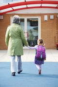 Grandparent Taking Grandchild To School - stock photo