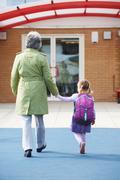 Grandparent Taking Grandchild To School Stock Photos