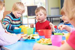 Pre School Children Eating Healthy Snacks At Breaktime - stock photo