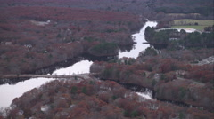 Over river and rural residential area south of Norwood, Massachusetts. Shot in Stock Footage