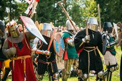 Historical restoration of knightly fights battle on festival of Stock Photos