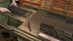 Stock Video Footage of Moving text block to printing press