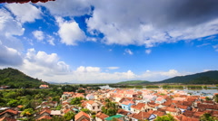 Upper View of Red Roofs Small City near River among Hills Stock Footage