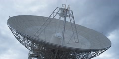 Close view of satellite tracking dish slowly turning Stock Footage