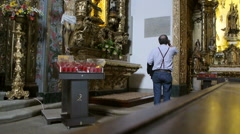 Man praying at the magnificent altar in the church of Porto, Portugal - stock footage