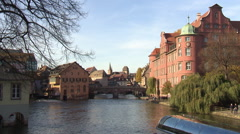 Channels in the city center of Strasbourg with tourist boat on the channel Stock Footage