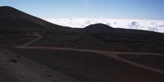 Overhead right pan of barren landscape veined with roads near cloudbank Stock Footage