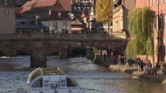 Town center of Strasbourg with tourist boat crossing the canal Stock Footage