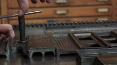 Setting up printing press 01 Stock Footage