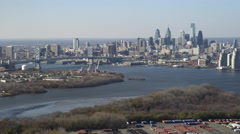 Aerial view of approach to Philadelphia and the Benjamin Franklin Bridge. Shot Stock Footage