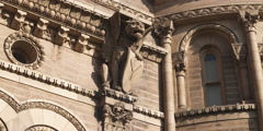 A winged lion gargoyle on an ornate building Stock Footage