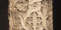 Pan up on details of an ornately carved pillar Stock Footage