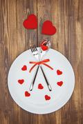 Celebrate valentine's day, Heart shape and dishware on a plate - stock photo