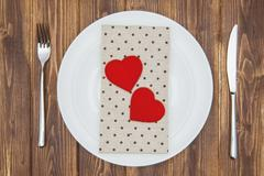 Celebrate valentine's day, Hearts shape and napkin on a plate - stock photo