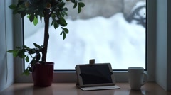 A mug of tea and a computer winter window - stock footage
