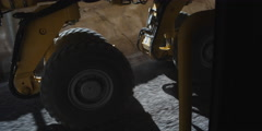 Axle-mount view of rolling dual wheels on a piece of heavy equipment Stock Footage